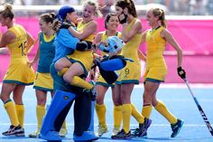 Celebrations after hockey win - Goalkeeper Toni Cronk (C) and Emily Smith celebrate after Australia's 1-0 win over the US at the London 2012 Olympic Games on August 2, 2012.