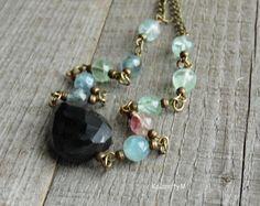 Smoky quartz I - fasetovaná nepravidelná záhněda tvoří hlavní část náhrdelníku, je doplněna o korálky fluoritu modro-zeleno-růžové barvy a bižuterní komponenty v barvě staromosazi, zapínání na karabinku. Záhněda je cca 2,4x1,7cm, fluoritové korálky mají průměr cca 0,6cm.  Délka náhrdelníku cca 46 cm. Délku mohu na požádání upravit. Beaded Bracelets, Jewelry, Fashion, Moda, Jewlery, Jewerly, Fashion Styles, Pearl Bracelets, Schmuck