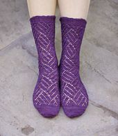 The Striation socks are mirrored and feature a cross hatched striated lace pattern which is striking in a rich color.
