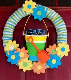 Dollar Tree Noodling Summer Wreath by Words on Wheels - pool noodle decked out in old beach towel strips and washcloth flowers, cute!!