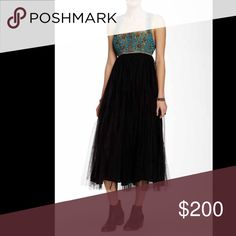 FreePeople gorgeous embroidered dress FreePeople gorgeous embroidery and mirror embellishments on the top open back with silk tie between shoulders midi dress mid calf length  black tulle with soft lining zipper closure down the back on bottom portion Free People Dresses Midi