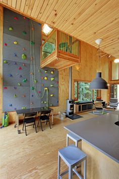 climbing wall. plywood walls and floor. tongue and groove ceiling. concrete-like counter top.