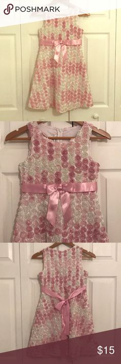 Girls dress Pink and white rose textured dress with round neckline. Pink satin bow that ties in the back with a zipper closure in the back as well. Never worn, but without tags. Bonnie Jean Dresses Formal