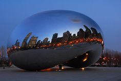 "The ""Bean"" in Chicago designed by Anush Kapoor. I think the idea of it is soo cool. It captivates the beautiful skyline.  This past Christmas i go to see in in person and its amazing. I love when you walk under it and look up the image you see is soo cool!"