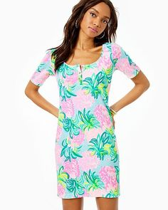 Straight fit, scoop neck henley t-shirt dress with gold buttons at front placket and elbow length From top of shoulder to hem (based on a size Above the knee. Neon Dresses, Comfy Dresses, Dress Lilly, Everyday Dresses, Tops For Leggings, Stretch Dress, Matching Outfits, Lilly Pulitzer, Dresses With Sleeves
