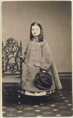 Little girl in a coat and curls, c. mid-19th C.