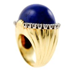 Lapis lazuli dome on an 18kt yellow gold shank surrounded by approximately 1ct of diamonds mounted on platinum. Circa 1960s