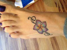 Plumeria foot tattoo. Ink Addiction. Yukon, Ok....pretty colors