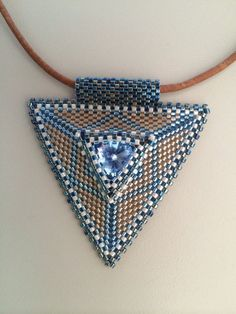 Denim blue triangle pendant by BeadSplashHCJ on Etsy