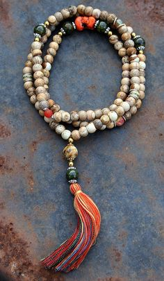 Mala made of 108, 9 x 10 mm - 0.354 x 0.394 inch, jasper gemstones and decorated with yakbone, agate, faceted agate and howlite - Made by look4treasures