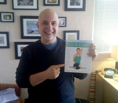 "your truly holding a copy of Tara Stiles new book ""Yoga Cures""...I take classes at her studio and you should to if you come to NYC. www.stralayoga.com"