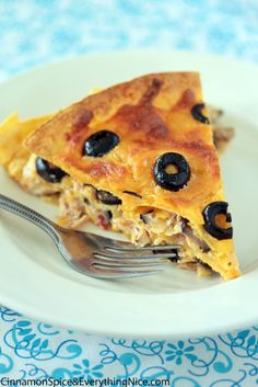 Santa Fe Chicken Bake...  layers of tortillas, chicken, black olives, salsa and cheese melded together with a yummy cream cheese sauce