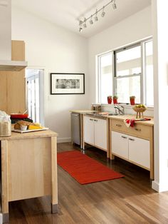 """Not loving the """"minimalist"""" cabinets ... but I AM loving the bright, airiness of the off-white with sunlight and a pop of color in accents."""