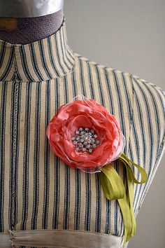 love the ticking cover on this dress form--also there is a tutorial for the satin flower brooch w button center