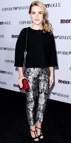 Kiernan Shipka made a statement in Emporio Armani, dressing up a black boxy top with statement iridescent printed pants that she styled with black s...