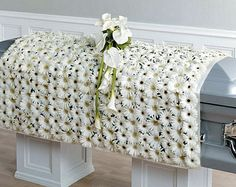 White Casket Blanket made with approx.500 white gerbera daisies.