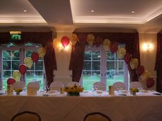 Burgundy roses-a-round and metallic gold arch at Beaulieu Hotel