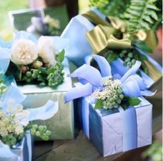 Gift Wrapping Idea - Love the idea of putting fresh flowers on a special gift!