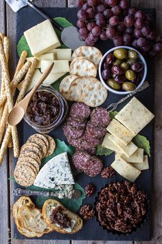 Creamy blue cheese, bacon jam, and a sweet candied walnuts make the perfect bite. Here's how to make a stunning cheese board.