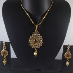 Designer White Stones Pendant Set with Gold Tone Chain With Pink Enamel