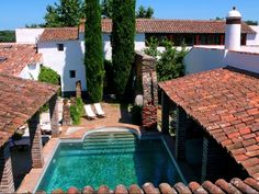 Click through to browse listings of Country Estates for sale in Reguengos De Monsaraz, Evora, Portugal, with a wide range of Portuguese properties added by real estate firms and developers worldwide. Country Estate, Modern Country, Hotels Portugal, Thatched Roof, Dream Pools, Beautiful Buildings, B & B, Art And Architecture, Condo