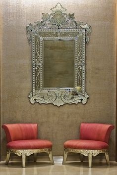 Venetian mirror, coral chairs & texture on walls