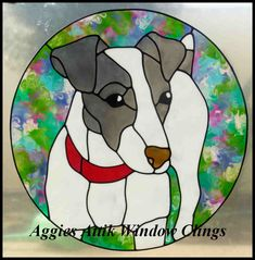 Jack Russell faux leadlight window cling / decal. Hand painted with gallery glass paint to give a stained glass effect. A variation on the usual brown/cream coat colour.