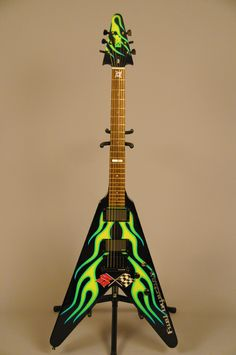 James Hetfield JH1 green flamed ESP Flying V. Note: The Corvette logo from the Original 53' at the base of the neck. ...Awesome!