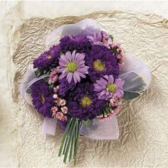 A corsage that looks like a bouquet. Purple asters & lavender mums would also look good in a prom nosegay!