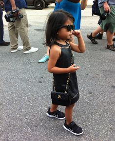 Now three years old, Alexander Wang's niece Aila Wang has progressed from leather pinafore dresses, to the halterneck version, which she accessorised with Wintour-esque shades and a black Chanel bag.