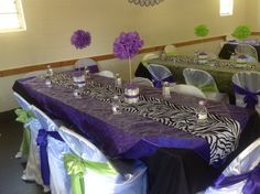 Zebra print, green and purple baby shower. Mini diaper cakes with tissue flowers.