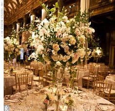Tall, crystal vases filled with peonies, hydrangeas and roses topped the tables.