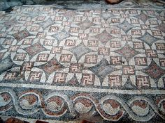 Yin Yang in Ancient Albania-Photos of a recently excavated Roman-era basilica in the Illyrian city of Bylis (Albania) showing Yin Yang and Swastikas symbols.  Alban means white