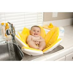 Blooming Bath Baby Bath. his infant bath is a unique, cozy and cute plush flower filled with soft, comfortable foam. The flower petals fold to create a cozy seat in the sink for bathing baby. This flower bath is bacteria and mildew resistant and can be machine washed for quick clean up. Makes a fun baby shower gift! Available in yellow, pink or blue.