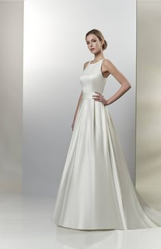 Venus Bridal · Jewel neckline matte satin a-line gown. Pleated band with  keyhole back with bow d3d661da2a0a