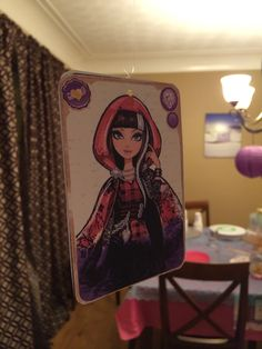 Col's Ever After High Party - decorations. Hanging cards with fishing line. Cerise hood is colleens favorite character.