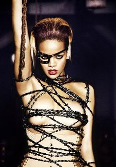 Google Image Result for http://i20.photobucket.com/albums/b242/play14u/rihanna-barb-wire-boobs.jpg