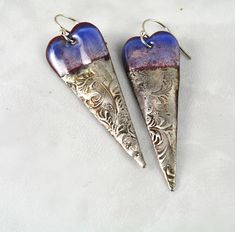 Long copper heart earrings with deep and light shades of blue & purple enamel with textured silver solder Fabulous mix of enamel and textured silver solder hanging on sterling silver ear wires. These would make a great addition to your collection of fabulous earrings. Approximately