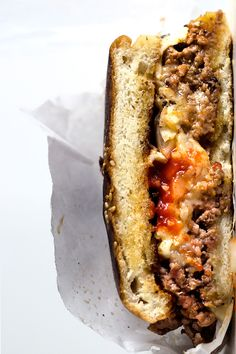 This Bronx specialty called chopped cheese, is spiced up even more with sriracha in the patty.