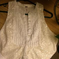 FREE PEOPLE sequin white tank top Free people button down Ruffle tank top blouse. Covered in white colored sequin. Long and flowy. Has a mini slit on the back. I love the originality of this shirt. Free People Tops Blouses