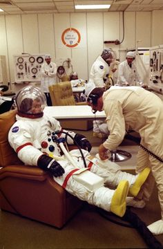 Gene Cernan suited up during a pressure check. Note how his suit is bright white. Photo: NASA ap17-72-HC-878HR