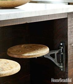 Stools on hinges save room in the kitchen. I think I'd find a way to add a fold-out back support on the stool.