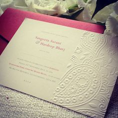Paisley embossed wedding invitation