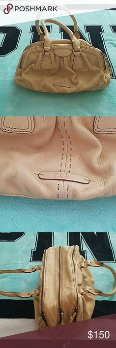 Price drop 😊 Authentic Cole Haan Leather bag Super cute roomy bag, 3 zippers, middle pocket has a zipper pocket plus 2 other pockets, gently worn, a small pink mark inside from lip liner other than that inside is perfect, small stain on one side towards bottom shown in pics, 14 inches long, 4.5 inches across bottom, 8.5 inches tall, gorgeous soft leather Cole Haan Bags Satchels