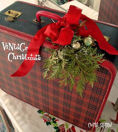 Love the plaid suitcase...great way to store Christmas deco and then use as a deco during the holiday