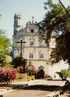 Portuguese style church in Goa, India. Click through to view Good Friday proceedings at a Goa church. Best Places To Travel, The Places Youll Go, Colonial, Modern Church, Goa India, Cathedral Church, Place Of Worship, World's Biggest, Adventure Is Out There