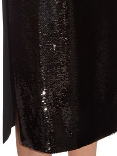 Rochas is synonymous with sophisticated silhouettes, and this black midi skirt is a standout example, enlivened by shimmering tonal sequins at the front. The heavyweight stretch-cady is cut to sit high on the waist and fall in a flattering, figure-skimming shape to just below the knees – the perfect length for barely there heels.