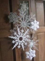 Dollar Store Snowflakes arranged using thin wire. Beautiful Door Decor for the Holidays!