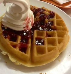 Waffle with Strawberry Jam and Vanilla Ice Cream.