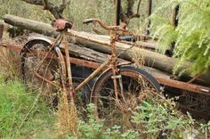Old rusty bicycle, forgotten near the house in the Italian mountains